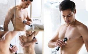 hombre joven usando una afeitadora corporal